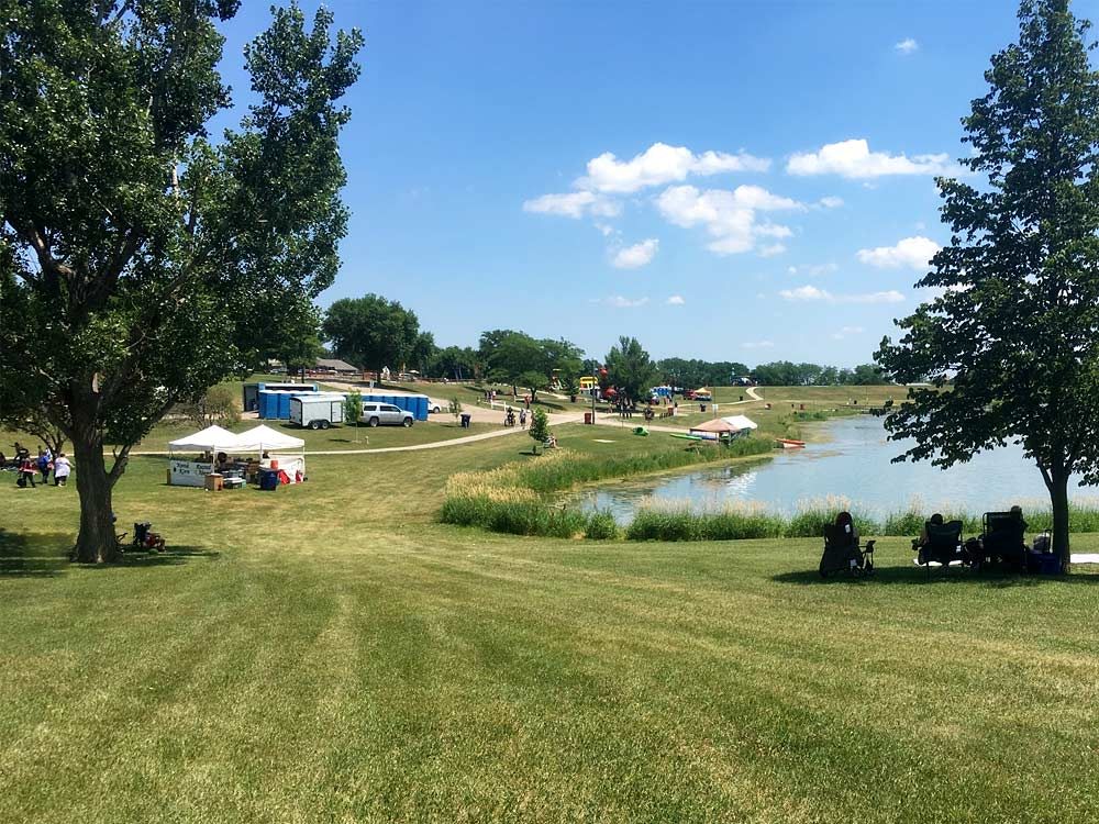 Skyview Lake, Big Bang Boom with fun events and people relaxing on lawn chairs