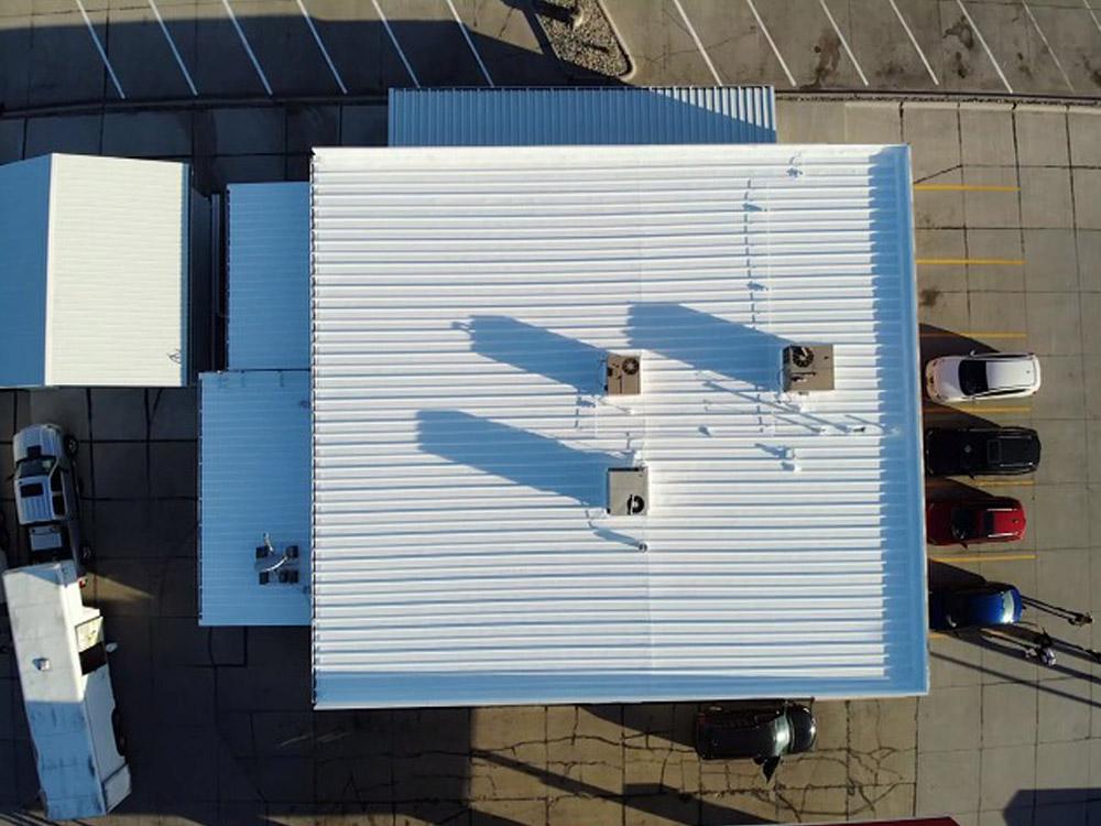 Northeast Nebraska Energy Systems, Inc. Liquor store roof metal restoration and roof spray foam project in Norfolk, Nebraska